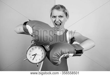 Punching A Clock. Time For Success. Win The Day. Angry Woman Boxing Gloves. Girl Boxer Hold Alarm Cl