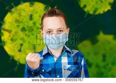 Sad Boy Show His Fist, Wearing A Protective Face Mask Prevent Virus Infection Or Pollution