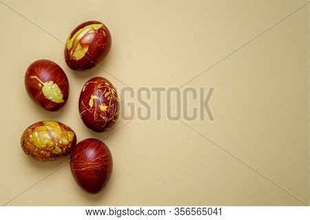 Chicken Eggs Colored With Old-fashioned Natural Method By Onion Husks Isolated On Light Brown. Topvi