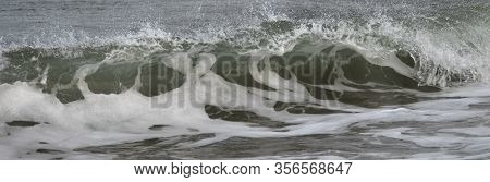 Turbulent Wave Crashing With Foam And Caps
