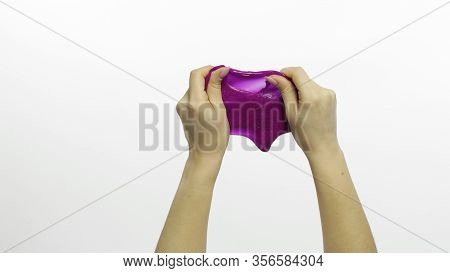 Woman Hands Playing With Oddly Satisfying Purple Slime On White Background. Sticky Gooey Substance.