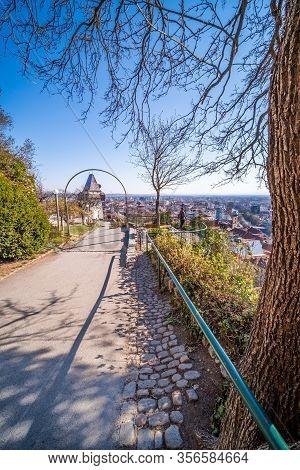 On The Hill Schlossberg With Tower Uhrturm In Deserted Town Graz, Styria At Virus Quarantine In Spri