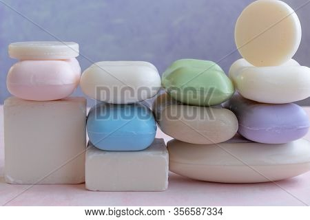Different Handmade  Bar Soaps On Pink Background. Hygiene, Artisanal Products