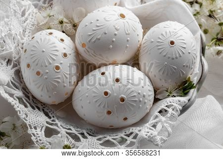 Detail Of Blown Out White Easter Eggs Decorated With Wax, With Drilled Holes