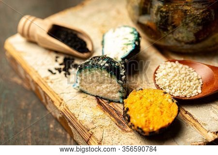 Various Types Of Cheese On Rustic Wooden Table. The Concept Of Eco Products. Organic Farm Dairy Prod