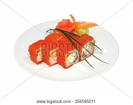 Rolls With Crab, Avocado And Tobiko With Pickled Ginger And Wasabi On White Round Plate. Close-up Of