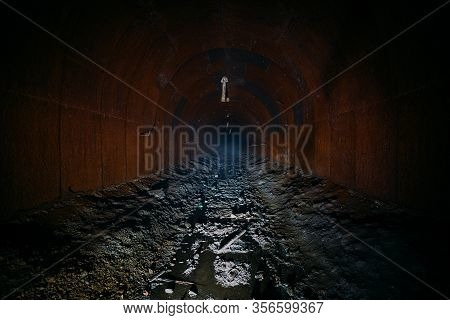 Dark Dirty Flooded Abandoned Vaulted Mine Tunnel