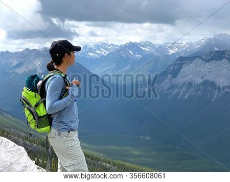 Woman Hiking Through Canadian Rockies At Mount Rundle In Banff National Park In Alberta Canada