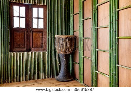 Musical Instrument Djembe Drum, Standing In The Corner Of The Bamboo Room As A Decoration