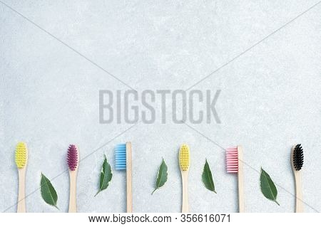 Eco Friendly Natural Bamboo Toothbrushes With Green Leaves