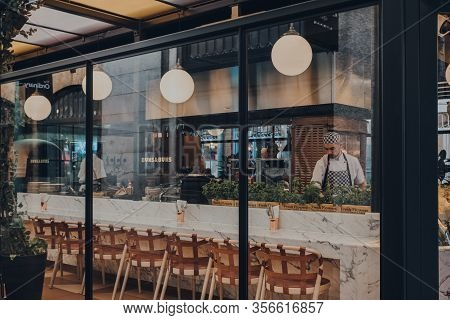 London Uk - March 06, 2020: View Through The Window Of Staff Cooking Inside The Restaurant In Covent