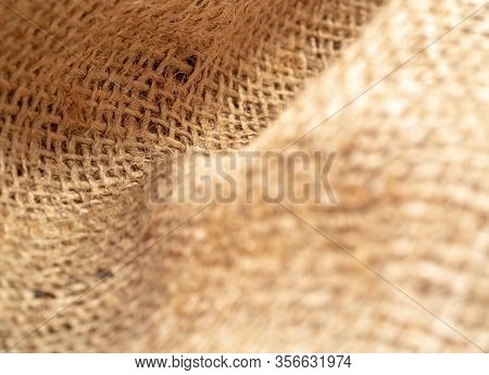 Crumpled Burlap Fabric, Close Up View. Texture Of Brown Sackcloth. Brown Burlap Textile, Abstract Ba