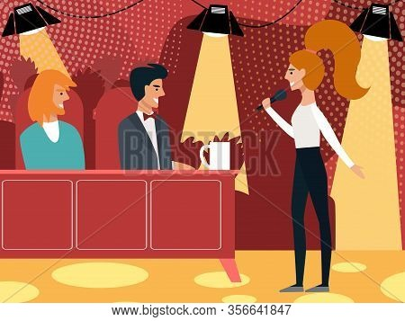Young Girl Singer Stand At Desk With Jury Performing On Talent Show. Smiling Judges At Table Listeni
