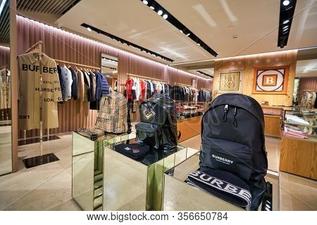 SINGAPORE - APRIL 21, 2019: interior shot of Burberry store in Singapore Changi Airport. Burberry Group PLC is a British luxury fashion house headquartered in London, England.