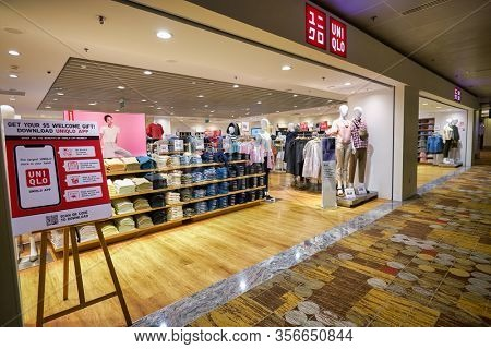SINGAPORE - APRIL 21, 2019: entrance to Uniqlo store in Singapore Changi Airport. Uniqlo is a Japanese casual wear designer, manufacturer and retailer.