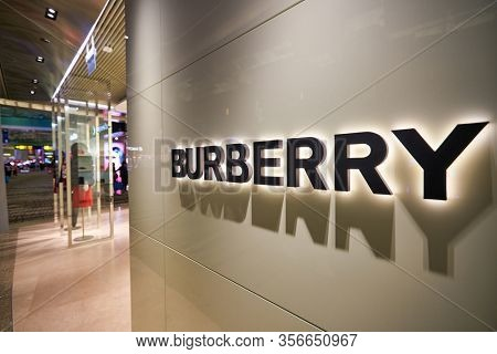 SINGAPORE - APRIL 21, 2019: close up shot of Burberry sign seen in Singapore Changi Airport. Burberry Group PLC is a British luxury fashion house headquartered in London, England.