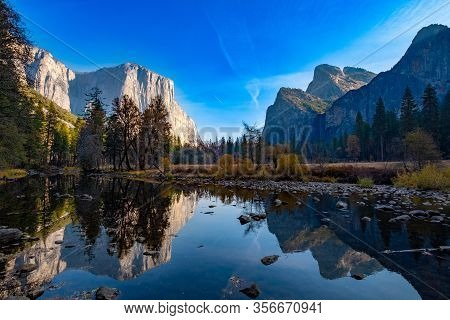Yosemite Landscape Seen From The Valley Floor With Merced River Reflection