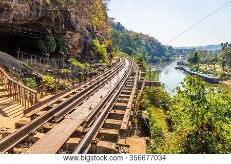 The Death Railway Crossing Kwai River With Krasae Cave In Kanchanaburi Thailand. Important Landmark