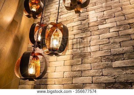 Decorative Antique Edison Style Filament Light Bulbs On Brick Wall Background
