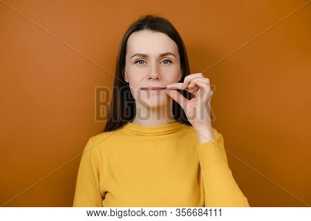 Mysterious Smiling Woman Looks Mysteriously, Aside Zips Her Mouth Shut, Promises To Keep Secret, Hol