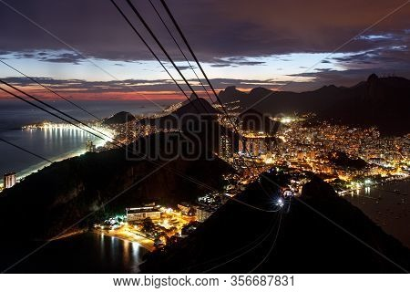 Panoramic View Of Rio De Janeiro, Brazil Landscape, Corcovado Moutain In Sunset.