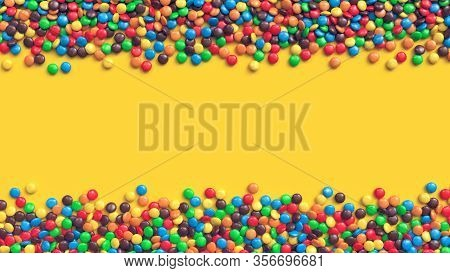 Double Border Of Colorful Coated Chocolate Candies On Yellow Background