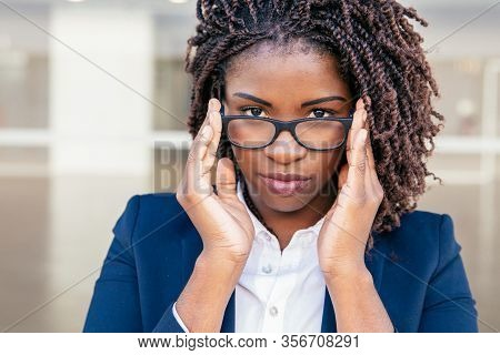 Confident Professional Touching Eyeglasses. Young African American Business Woman Adjusting Eyewear,