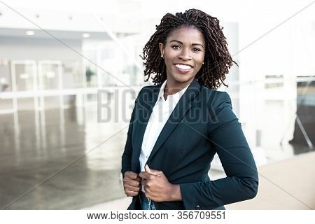 Happy Confident Professional Posing Near Office Building. Young African American Business Woman Stan