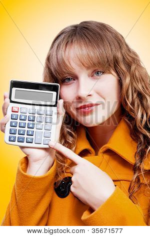 Woman Pointing To Calculator Keypad