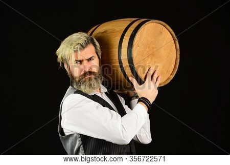 Sommelier Examining Wine. Barrel Of Wine. Bartender At Cellar With Exquisite Drink. Experienced Somm