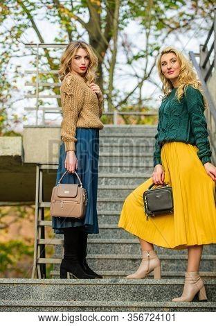 Enjoying Autumn Day. Autumn Women Outdoor. Girl Friends Go Upstairs. Fall Season Color Trends. Pleat