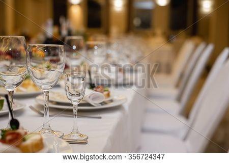 Elegant Dinner Table Setting In Restaurant Or Hotel With Wine Glasses. Luxurious Elegant Dinner At T