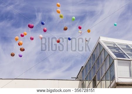 Light Balloons Released By Children Float In The Air On A Holiday. Beautiful Balloons Are Flying Aga