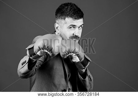 Full Of Energy. Bearded Man In Boxing Gloves Punching. Business And Sport Success. Powerful Man Boxe