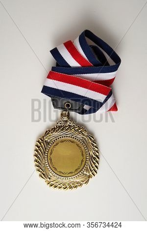 winning medal on the white background