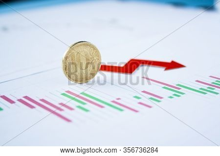 Ten Rouble Coin On Currency Graph With Red Arrow Down. Exchange Rate Chart. Ruble Depreciation. Exch