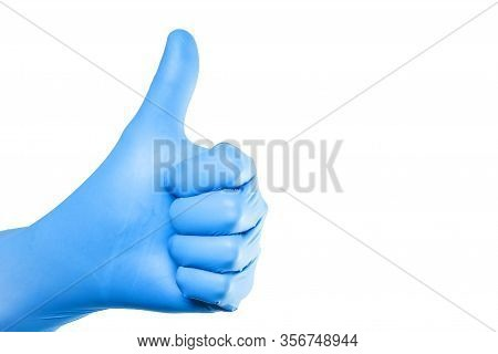 Thumb Up Approval Symbol. Hand In Blue Latex Glove Isolated On White Showing Ok Sign. Empty Copy Spa