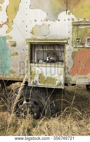 Old, Rusty Abandoned Trailer, A Shelter On Wheels For The Homeless.