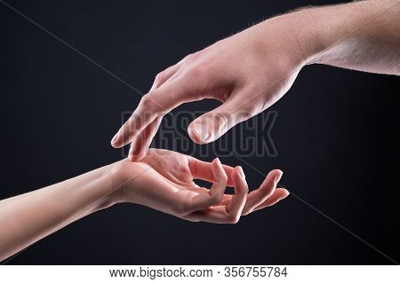 Close-up Two Beautiful Hands Of A Man And A Woman In A Gentle Gesture Of Touch. The Concept Of Tende