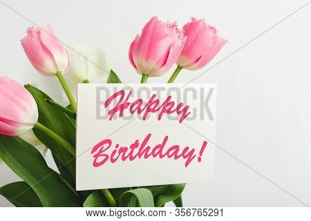 Happy Birthday Text On Gift Card In Flower Bouquet. Beautiful Bouquet Of Fresh Flowers Tulips With G