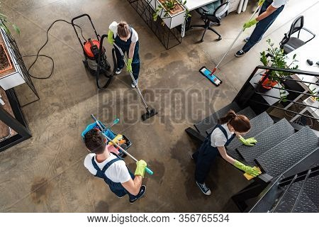 Top View Of Cleaning Company Team Cleaning Modern Office