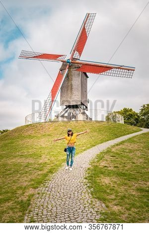 Brugge Belgium, Colorful House At The Old City Of Brugge , Young Woman Free In The City By The Old W