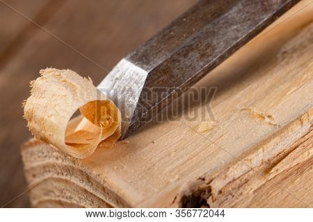 Chisel Work In Wood And Raw Wood Shavings. Tools And Accessories In A Carpentry Shop.