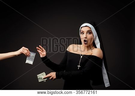 Shocked Sexy Nun With Money Buying Plastic Bag Of Cocaine Isolated On Grey