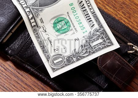 Dollars, Money And Wallet On A Wooden Table. One Dollar. Purse With Money.