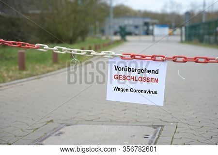 Red White Chain Barrier In Front Of A Company And Sign With German Text Vorübergehend Geschlossen, W