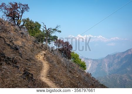 A Trail On A Mountaintop With The Snow Peaks Of The Himalaya Mountain Range In The Distance