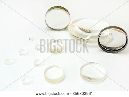 Lenses. Magnifying Optical Lenses Close- Up On A White Background. Glass Magnifiers Isolated On A Wh
