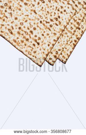 Passover Matzo, Matzah, Or Matza Unleavened Flatbread Isolated On White Background. Matzah Is Part O