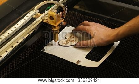 Laser Cutting Beam Over Plywood Sheet